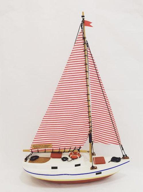 Barco veleiro vermelho e vermelho