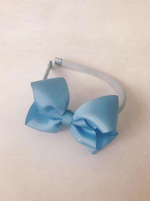 Tiara laço boutique azul bebê