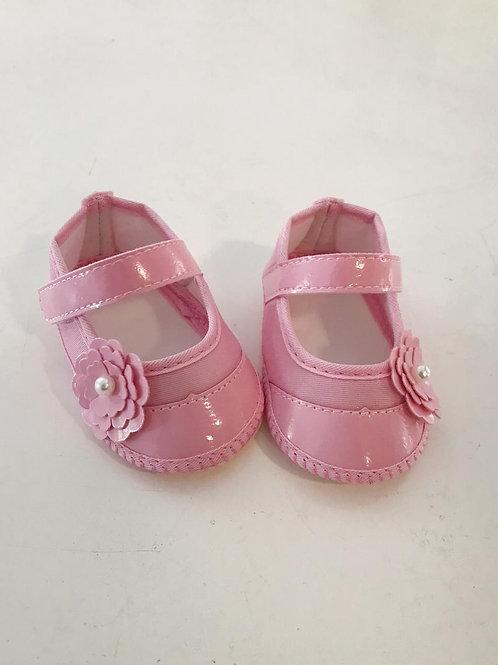 Sapato rosa com flor e pérola