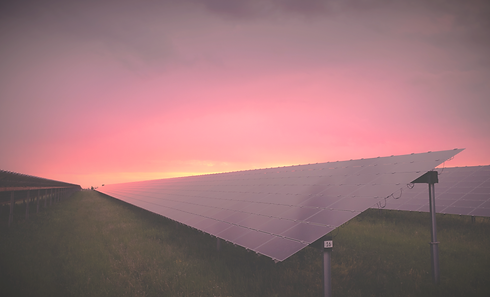 black solar panel under red and gray clouds_edited.png