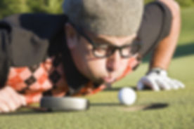 golfer-blowing-ball-into-hole-56a3d6635f