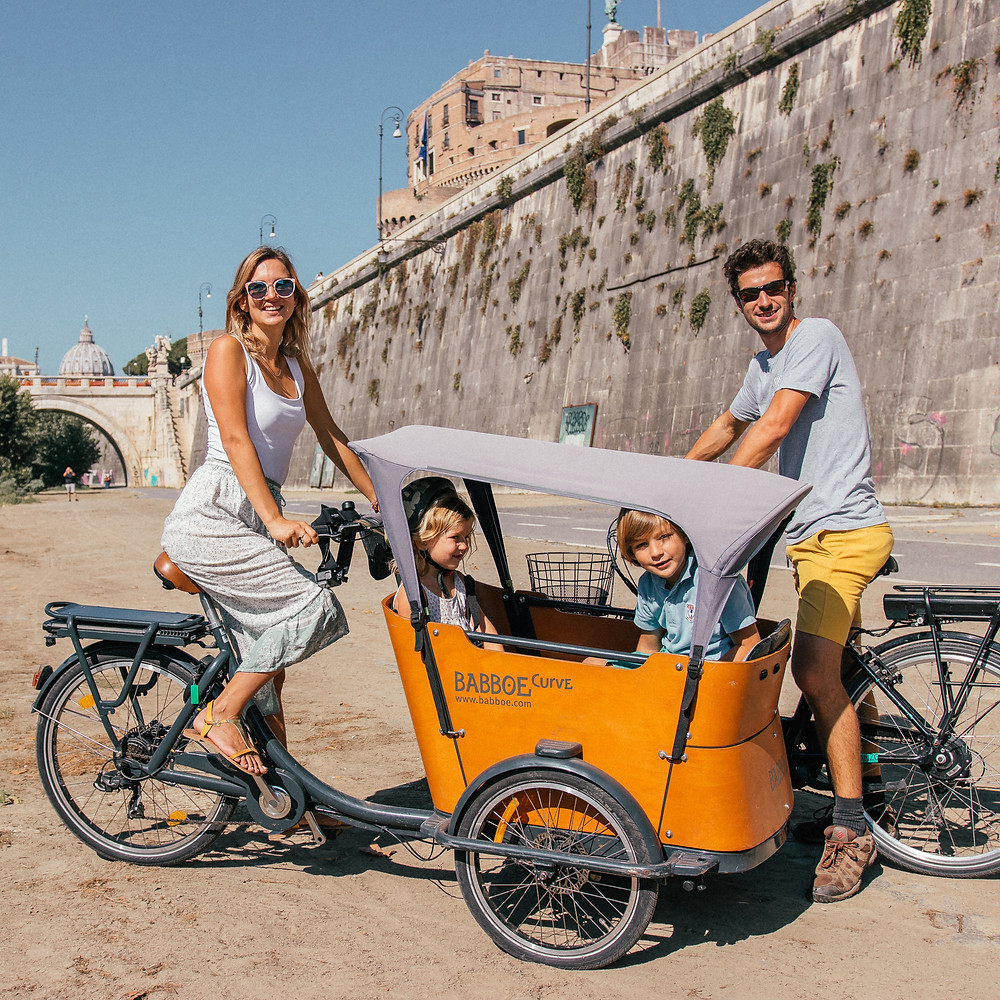 Bike ride with kids at the Tibre, Rome, Italy