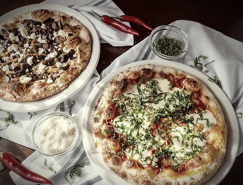 Two pizzas on a table