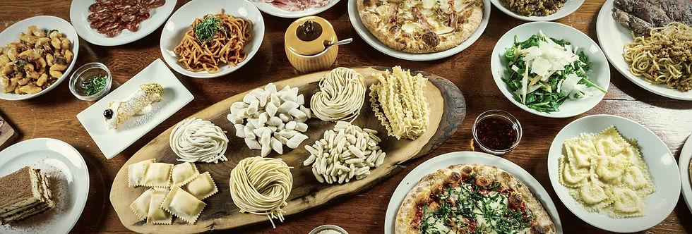 Table full of Italian Food