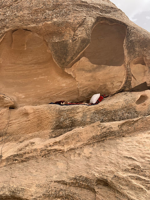 a pillow and blanket in little petra jordan tours
