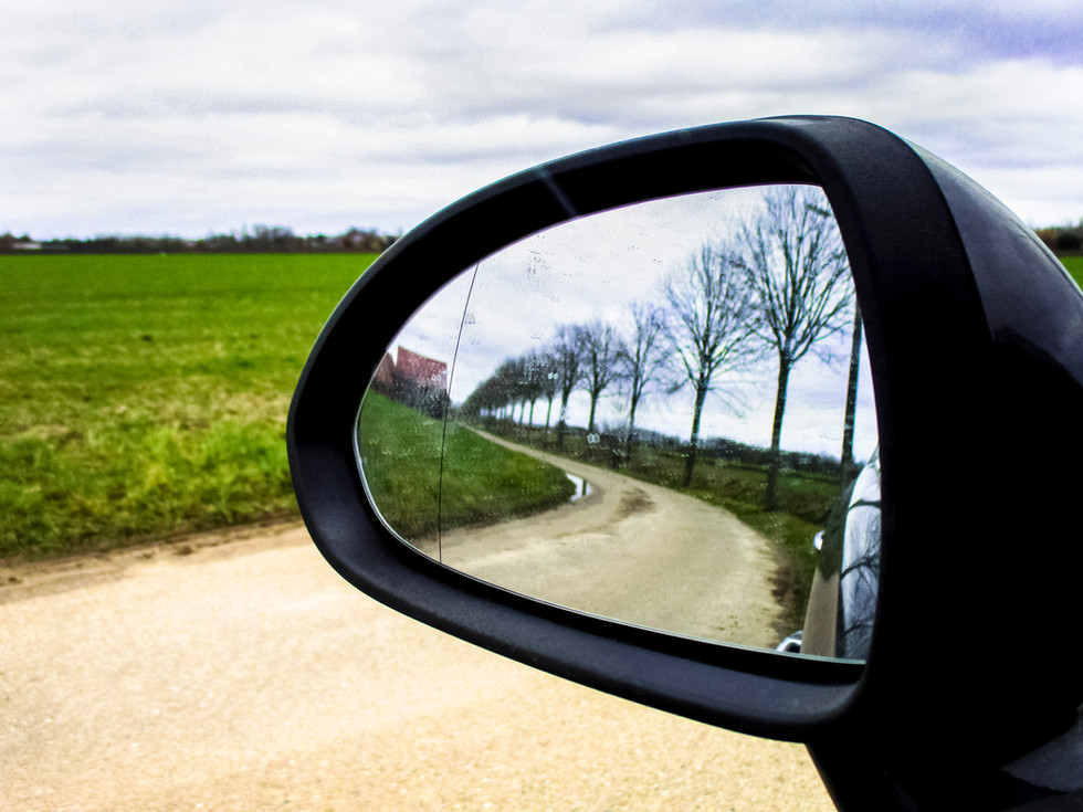 A never-ending ride  You're looking in your side mirror so actually you're looking back but the road just continues.