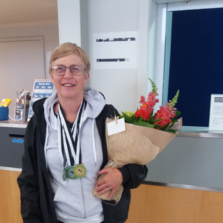 Successful gold and silver medallist Carolyn Wilks arriving home from the International Deaf Bowls tournament