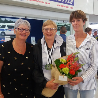 Welcoming home Carolyn Wilks is Sharon Spiers and Maree Gadsby
