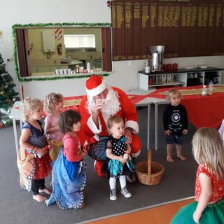 The kids enjoying Santa visit.