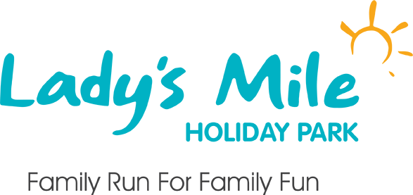 Lady's Mile Holiday Park Logo - The latest holiday park to install a modular pumptrack for wheeled sports fun!