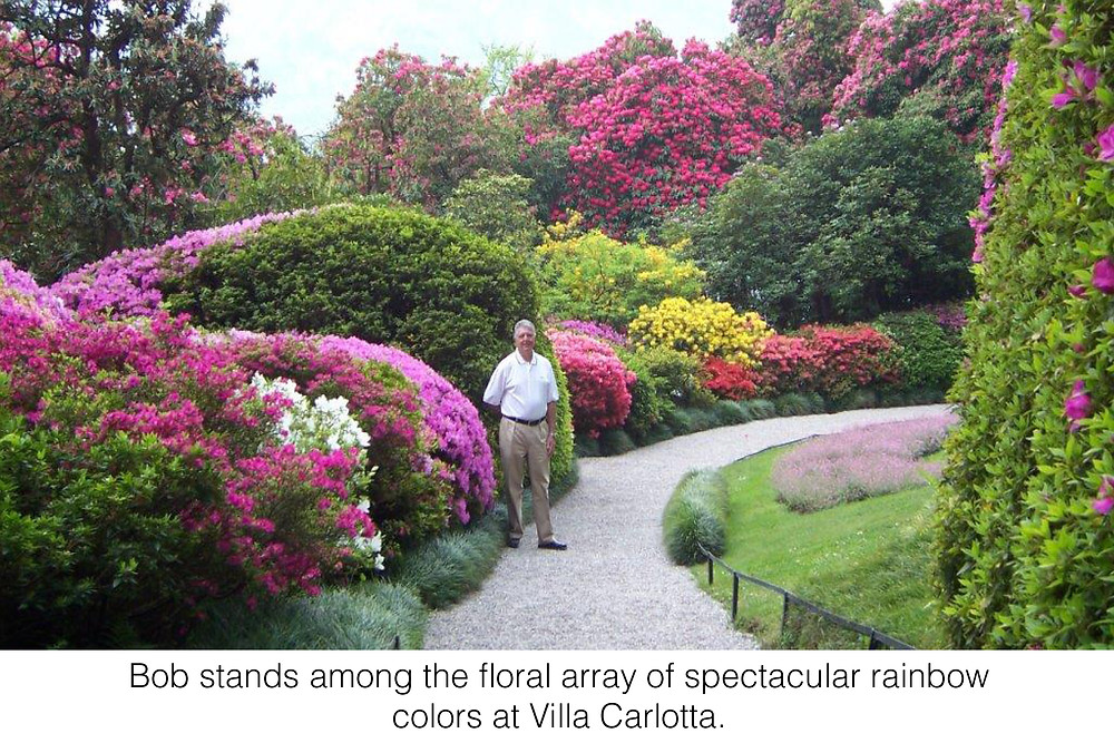 bob stands among the floral array of spectacular rainbow colors at Villa Carlotta.