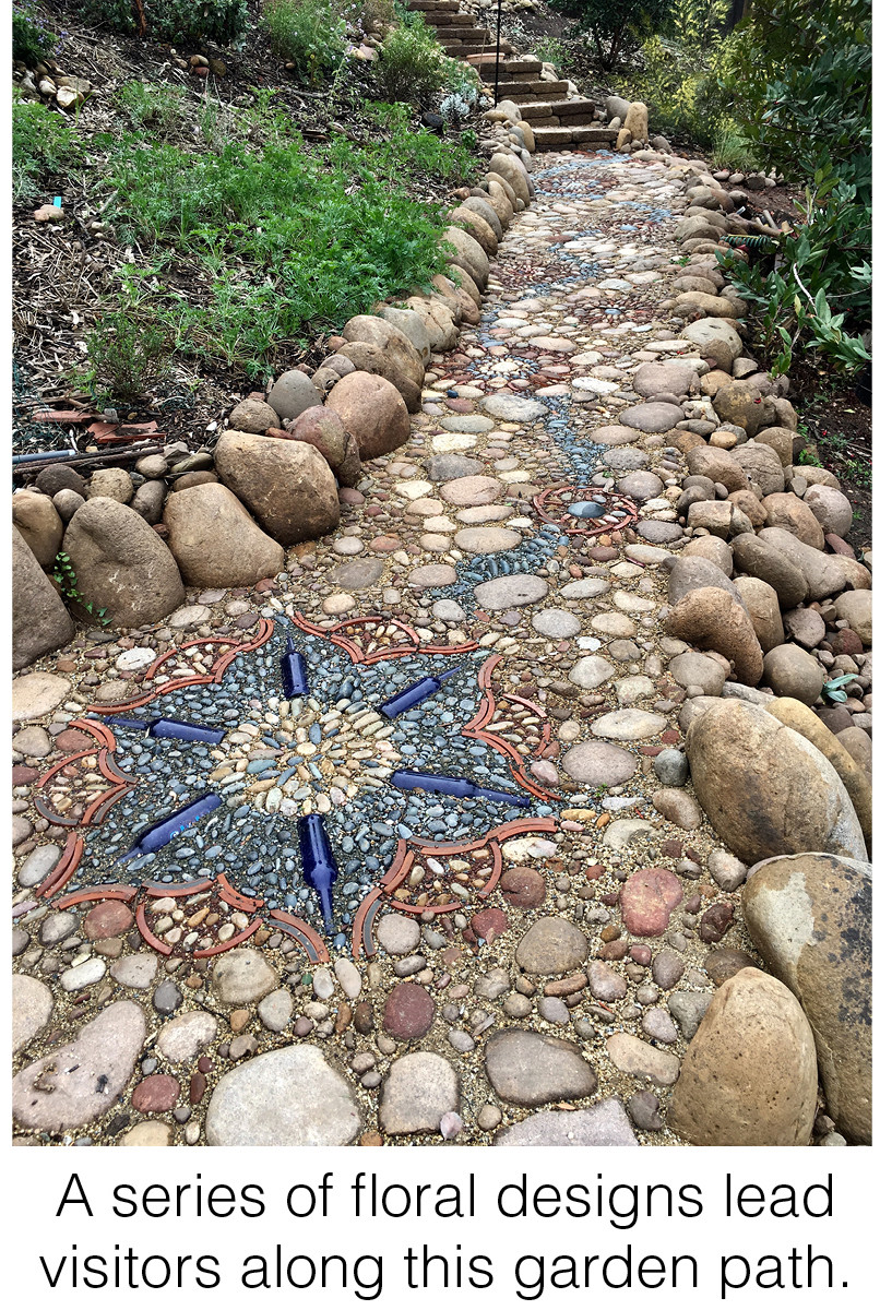 A series of floral designs lead visitors along this garden path.