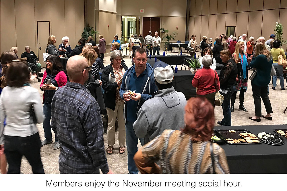 Members enjoy the November meeting social hour.