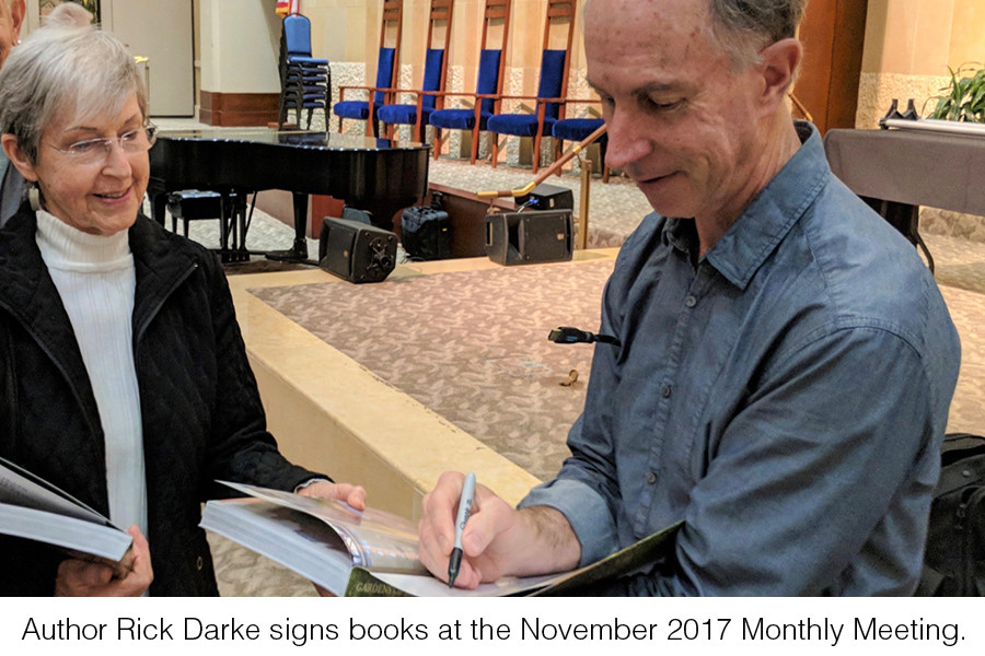Author Rick Darke signs books at the November 2017 Monthly Meeting.