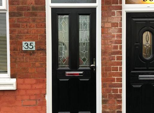 Timeless black double pane composite door
