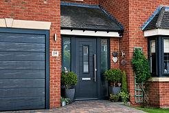dark grey composite door with side panels