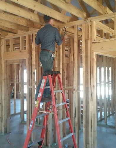 Plumber Installing Plumbing In New Construction Home