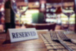 reserved-sign-on-restaurant-table-with-b