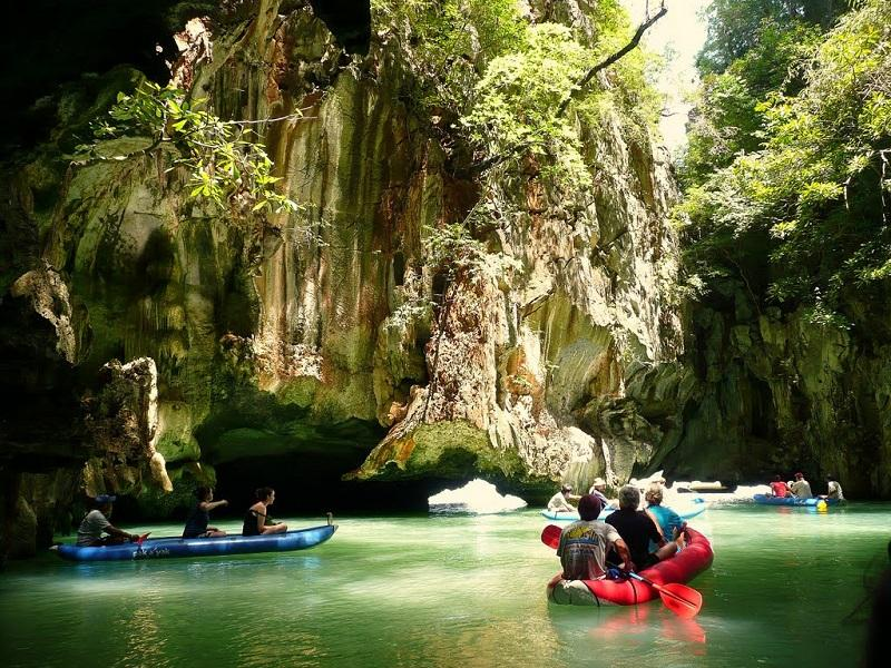 Canoe through spectacular caves