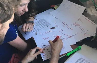 A photo of Morgan Delarue & Lisa Dennison creating a science sketch.