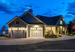 Authentic looking insulated steel and composite carriage house garage doors.