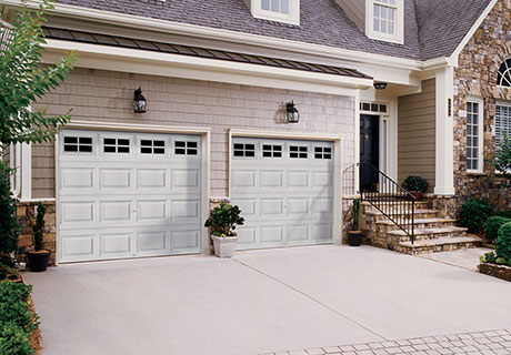 Classic short or long panel steel garage doors with or without insulation.
