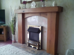 fireplace surround with cross board, danish oil, rustic, edges smoothed out