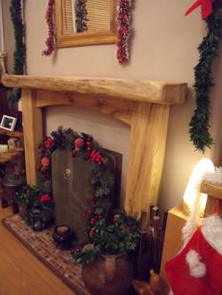 Rustic oak fireplace surround