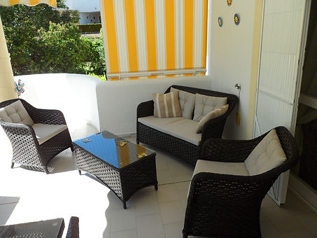 Balcony area with pool and lounge furniture
