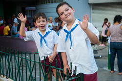 School kids waving