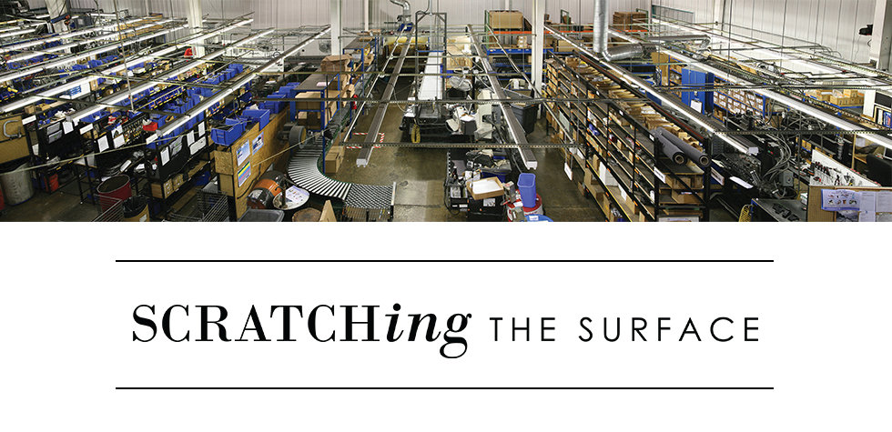 Scratching the Surface Logo with Production Floor