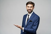 portrait-young-businessman-pointing-blan