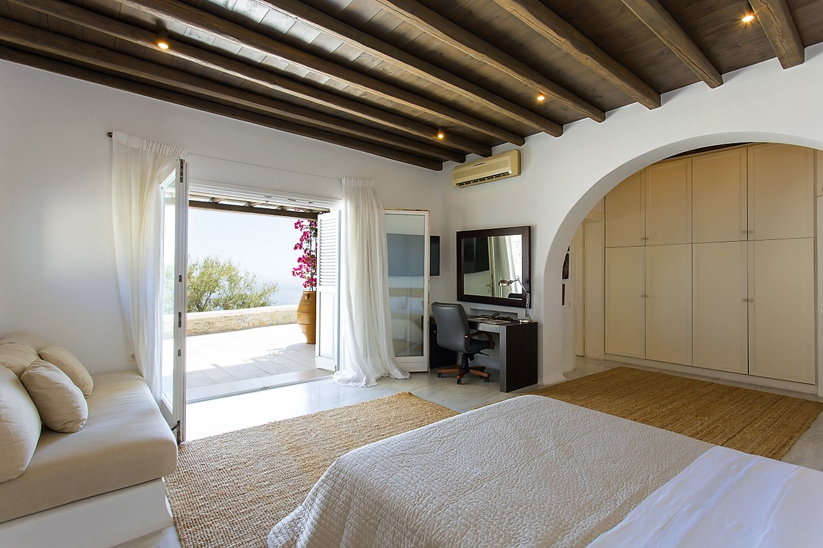 Mykonos villa guest bedroom with balcony and waterview