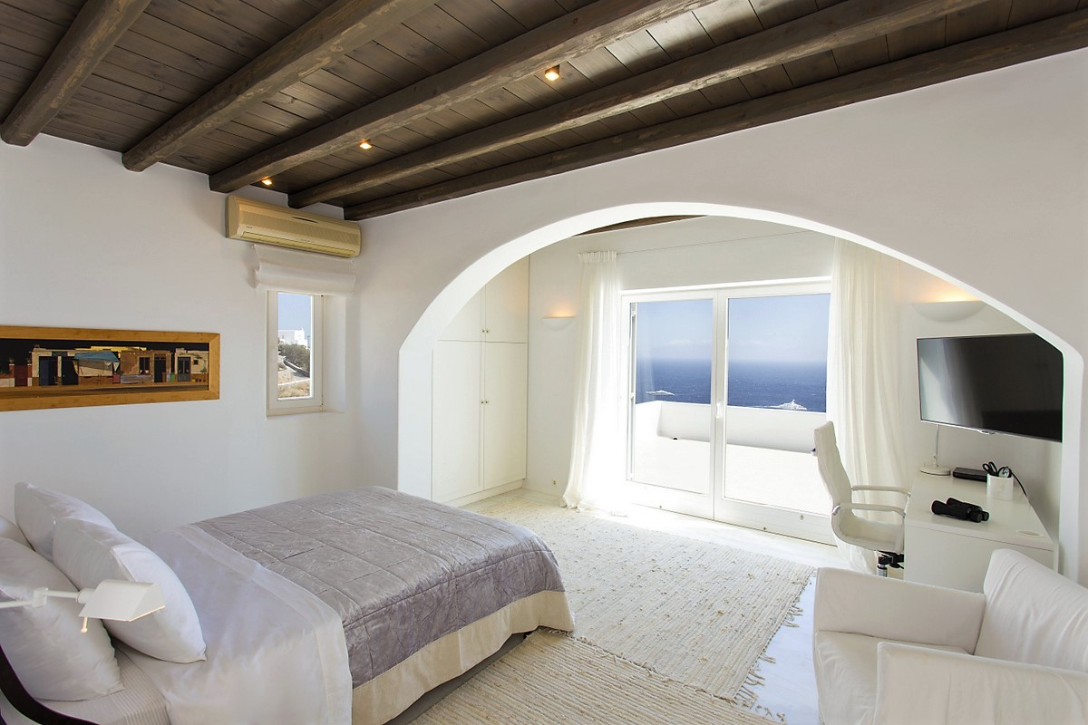 Mykonos villa guest bedroom with balcony and water view
