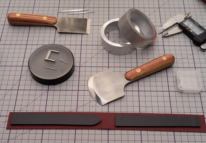 Strap making tools and parts.