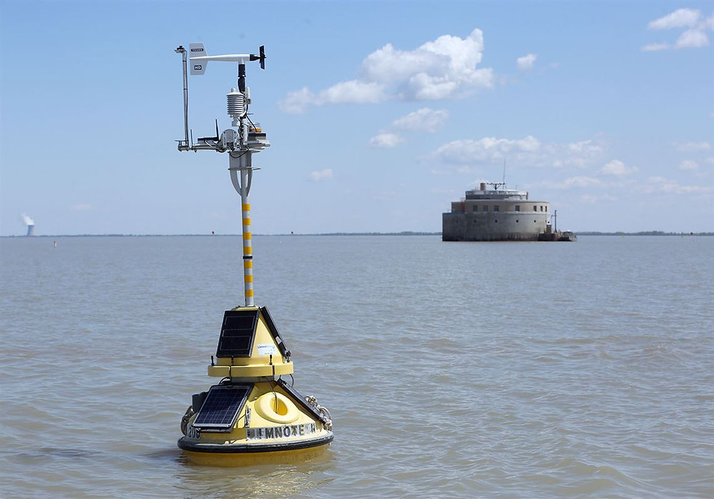 A buoy and the water intake for the City of Toledo are seen in Lake Erie.