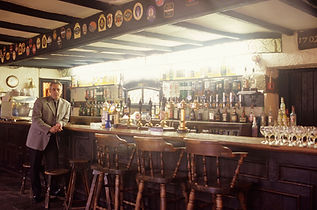 Man standing at the bar at ByWard Market in Ottawa