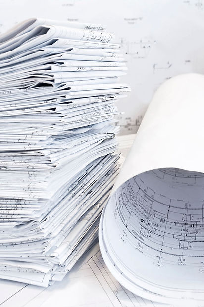 stack-of-design-drawings-lies-on-table-B