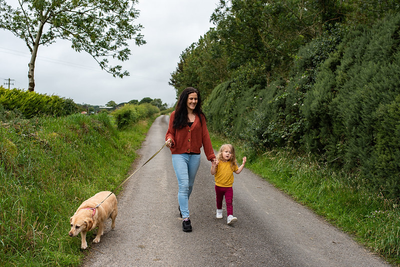marie o mahony photography mother walking her dog with her kid