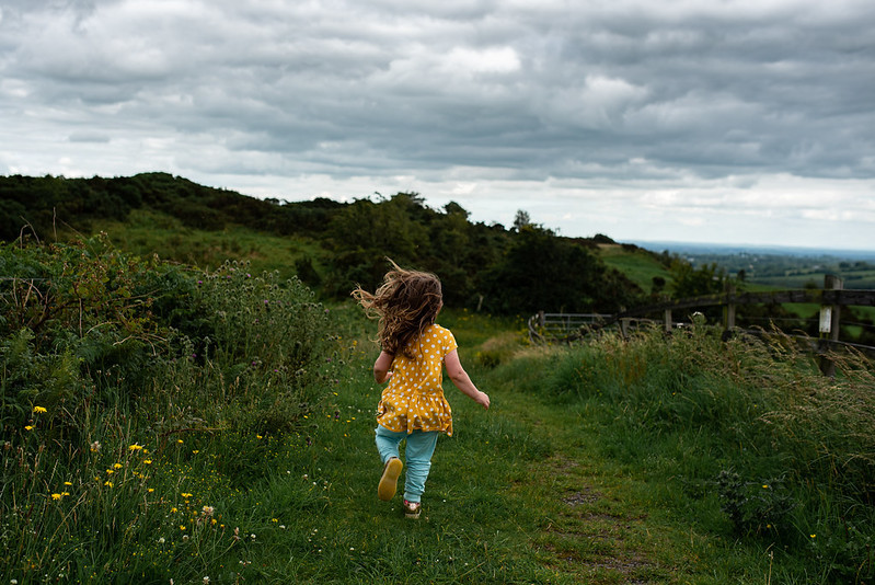 marie o mahony photography little girl running down mullagh hill County Cavan