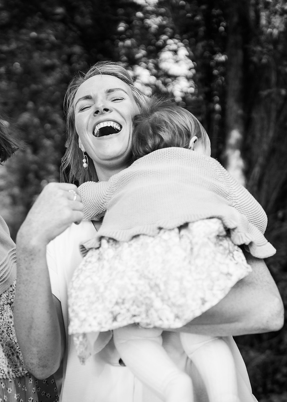 mother holding her baby and laughing, black and white photoshoot cavan