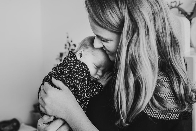 mother hugs newborn girl