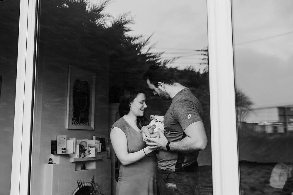lifestyle newborn black and white window shot