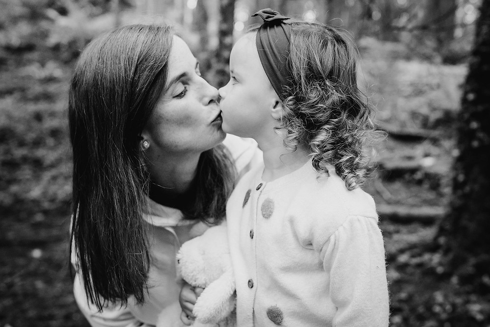 mother and daughter kissing , cavan , black and white photo