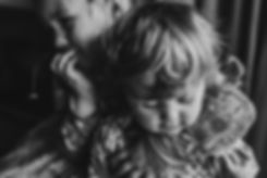 natural black and white portrait of two little sisters