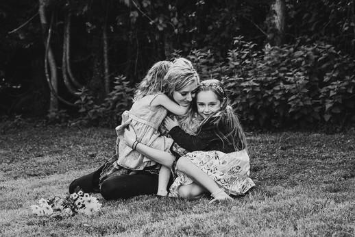daughters hugging their mam