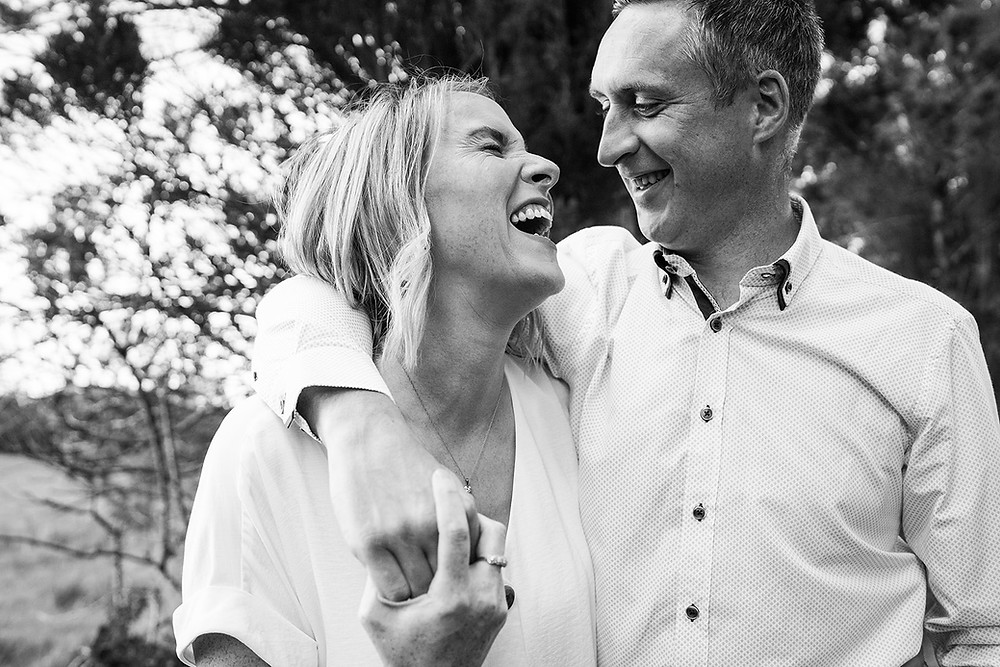 couple laughing together , black and white portrait