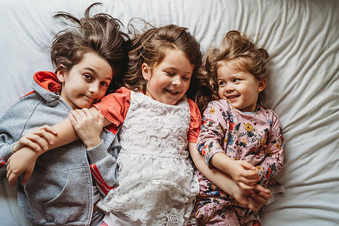 family photographer dublin photo of three kids smiling and laughing together