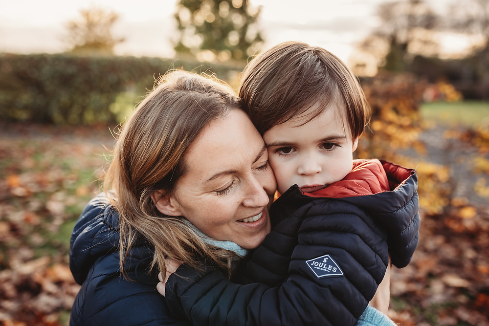 mother and son hugging, colour photograph, cavan