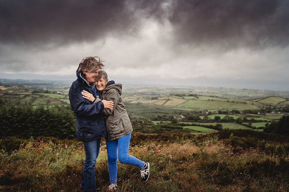 couples photoshoot cavan older couple laughing on a stormy day